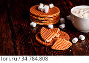Syrup Waffles with Broken One with White Cup of Cocoa with Marshmallow... Стоковое фото, фотограф Zoonar.com/Vsevolod Belousov / easy Fotostock / Фотобанк Лори