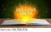 CREATIVE IDEAS inscription coming out from an open book, educational... Стоковое фото, фотограф Zoonar.com/ranczandras / easy Fotostock / Фотобанк Лори