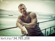 Handsome young muscle man at the seaside, outdoors, in front of the... Стоковое фото, фотограф Zoonar.com/Stefano Cavoretto / easy Fotostock / Фотобанк Лори