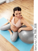 happy pregnant woman with fitball at home. Стоковое фото, фотограф Syda Productions / Фотобанк Лори