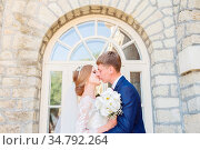 Portrait of a newlywed couple on a wedding walk. Concept of a happy... Стоковое фото, фотограф Zoonar.com/Ian Iankovskii / easy Fotostock / Фотобанк Лори