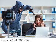 Criminal recording message for ransom with victim businesswoman. Стоковое фото, фотограф Elnur / Фотобанк Лори