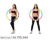A girl in sport suit with hula hoop isolated on white. Стоковое фото, фотограф Elnur / Фотобанк Лори