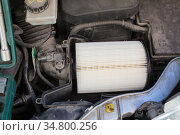 New clean air filter for vehicle engine is mounted in plastic box, close-up view. Стоковое фото, фотограф Кекяляйнен Андрей / Фотобанк Лори