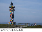 The Lighthouse of the Cantabrian town of Ajo (Bareyo) decorated by... Редакционное фото, фотограф Joaquín Gómez / age Fotostock / Фотобанк Лори