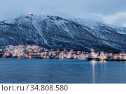 Port and harbour with famous Tromso Bridge across Tromsoysundet strait... Стоковое фото, фотограф Zoonar.com/Pawel Opaska / easy Fotostock / Фотобанк Лори