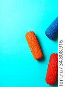Painted corn on a blue background. Стоковое фото, фотограф Zoonar.com/Yeko Photo Studio / easy Fotostock / Фотобанк Лори