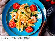 Strozzapreti pasta with spinach and shrimp. Стоковое фото, фотограф Zoonar.com/Darius Dzinnik / easy Fotostock / Фотобанк Лори