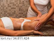 Woman having massage with cream at spa, closeup photo. Beauty, healthy... Стоковое фото, фотограф Zoonar.com/Ruslan Olinchuk / easy Fotostock / Фотобанк Лори