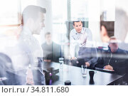 Business team brainstorming on meeting in modern corporate office... Стоковое фото, фотограф Zoonar.com/Matej Kastelic / easy Fotostock / Фотобанк Лори