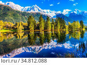 Snowy peaks of the Alps are beautifully reflected in the lake. Concept... Стоковое фото, фотограф Zoonar.com/kavram / easy Fotostock / Фотобанк Лори