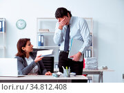 Old female boss and young male employee in the office. Стоковое фото, фотограф Zoonar.com/Elnur Amikishiyev / easy Fotostock / Фотобанк Лори