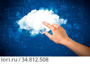 Female hand touching cloud with blue background. Стоковое фото, фотограф Zoonar.com/Rancz Andrei / easy Fotostock / Фотобанк Лори