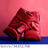 Pair of red leather boxing gloves on a blue background, sports equipment... Стоковое фото, фотограф Zoonar.com/Danko Natalya / easy Fotostock / Фотобанк Лори