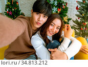 Young asian adult teenager coupletake selfie photographing for celebrateing... Стоковое фото, фотограф Zoonar.com/Vichaya Kiatying-Angsulee / easy Fotostock / Фотобанк Лори