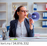 The angry businesswoman yelling with loudspeaker in office. Стоковое фото, фотограф Zoonar.com/Elnur Amikishiyev / easy Fotostock / Фотобанк Лори