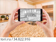 Hands Holding Smart Phone Displaying Drawing of Custom Kitchen Photo... Стоковое фото, фотограф Zoonar.com/Andy Dean Photography / easy Fotostock / Фотобанк Лори