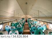 Interior of an old passenger plane. Стоковое фото, фотограф Андрей Радченко / Фотобанк Лори