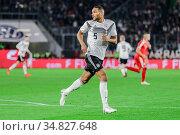 Wolfsburg, Germany, March 20, 2019: Jonathan Tah (GER) runs in the... Редакционное фото, фотограф Michele Morrone / age Fotostock / Фотобанк Лори