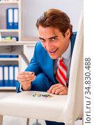 Office prank with sharp thumbtacks on chair. Стоковое фото, фотограф Zoonar.com/Elnur Amikishiyev / easy Fotostock / Фотобанк Лори
