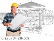 Male Contractor With House Plans Wearing Hard Hat In Front of Custom... Стоковое фото, фотограф Zoonar.com/Andy Dean Photography / easy Fotostock / Фотобанк Лори