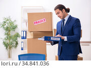 Young male logistics specialist working in the office. Стоковое фото, фотограф Elnur / Фотобанк Лори