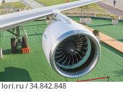 Турбореактивный американский двигатель Pratt & Whitney PW1400G российского нового пассажирского самолета МС-21-300 номер 73054 на авиасалоне МАКС-2019, Жуковский, Россия. Редакционное фото, фотограф Малышев Андрей / Фотобанк Лори