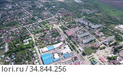 Aerial view of modern residential areas of small Russian city of Ozyory in sunny spring day. Стоковое видео, видеограф Яков Филимонов / Фотобанк Лори
