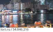 Timelapse of harbour maharaj and ferry area on Chao Phraya River. Night illumination at Bangkok, Asia, Thailand, NOV 22, 2018. Редакционное видео, видеограф Александр Маркин / Фотобанк Лори