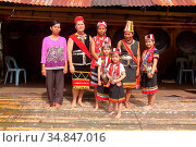 Celebrating Gawai with traditional costume at long house near kuching... (2016 год). Редакционное фото, фотограф Chew Chun Hian / age Fotostock / Фотобанк Лори