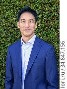 An elegant adult Asian man, San Diego, Californiaplant,bush,bushesâ.,. Стоковое фото, фотограф Julia Hiebaum / age Fotostock / Фотобанк Лори