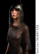 Sexy female wearing viking helmet and hauberg isolated view on black... Стоковое фото, фотограф Zoonar.com/Andrey Guryanov / easy Fotostock / Фотобанк Лори