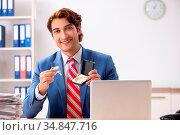 Deaf employee using hearing aid in office. Стоковое фото, фотограф Zoonar.com/Elnur Amikishiyev / easy Fotostock / Фотобанк Лори