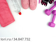 Pair of pink leather sneakers, plastic dumbbells and gloves for sports... Стоковое фото, фотограф Zoonar.com/Danko Natalya / easy Fotostock / Фотобанк Лори