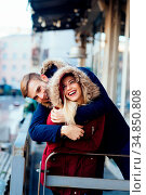 Young smiling happy european couple hugging in winter. Happy couple... Стоковое фото, фотограф Zoonar.com/Oleksii Hrecheniuk / easy Fotostock / Фотобанк Лори