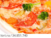 flavored pizza with broccoli, tomatoes and vegetables. Стоковое фото, фотограф Анна Гучек / Фотобанк Лори