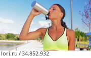 woman drinking water from bottle after sports. Стоковое видео, видеограф Syda Productions / Фотобанк Лори