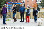 Children playing rubber band jumping game and laughing. Стоковое фото, фотограф Яков Филимонов / Фотобанк Лори