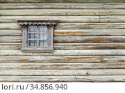 Old grungy green wooden wall with window. Стоковое фото, фотограф EugeneSergeev / Фотобанк Лори