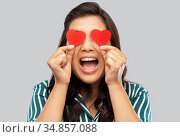 happy asian woman covering her eyes with red heart. Стоковое фото, фотограф Syda Productions / Фотобанк Лори