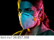 young woman wearing protective mask or respirator. Стоковое фото, фотограф Syda Productions / Фотобанк Лори
