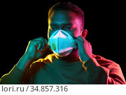 african american man in mask or respirator. Стоковое фото, фотограф Syda Productions / Фотобанк Лори