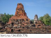 На руинах древнего буддистского храма Wat Phra Pai Luang солнечным днем. Сукхотай, Таиланд (2016 год). Стоковое фото, фотограф Виктор Карасев / Фотобанк Лори