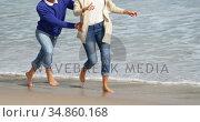 Mature couple enjoying on beach. Стоковое видео, агентство Wavebreak Media / Фотобанк Лори