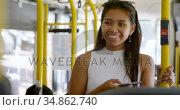 Teenage girl with mobile phone standing in the bus 4k. Стоковое видео, агентство Wavebreak Media / Фотобанк Лори