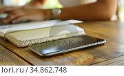 Teenage girl using laptop in restaurant 4k. Стоковое видео, агентство Wavebreak Media / Фотобанк Лори