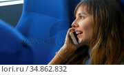 Woman talking on mobile phone while travelling in ferry 4k. Стоковое видео, агентство Wavebreak Media / Фотобанк Лори