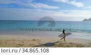 Female surfer with surfboard walking in the beach 4k. Стоковое видео, агентство Wavebreak Media / Фотобанк Лори