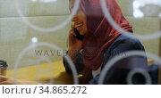 Woman talking on mobile phone in cafeteria 4k. Стоковое видео, агентство Wavebreak Media / Фотобанк Лори