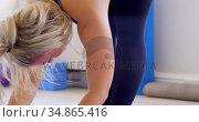Woman doing yoga in fitness studio 4k. Стоковое видео, агентство Wavebreak Media / Фотобанк Лори